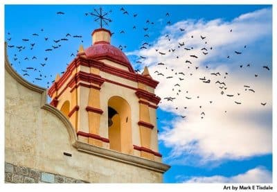 Birds in flight behind a beautiful bell tower on a church in Oaxaca Mexico - Print by Mark Tisdale