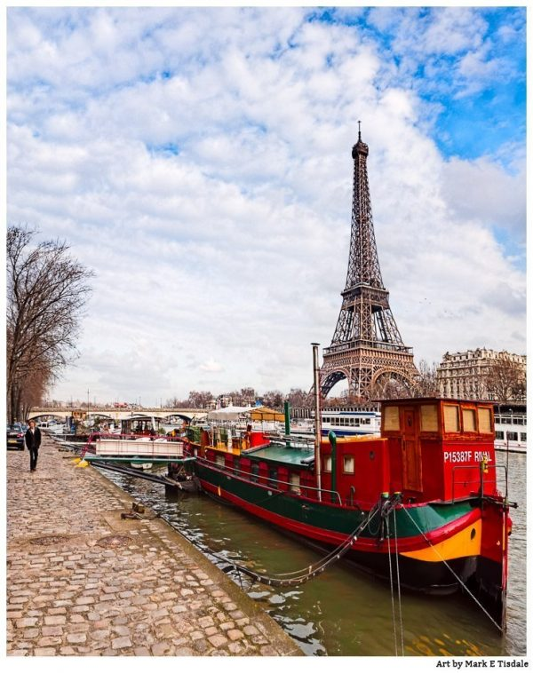 Eiffel Tower with a red boat in the foreground on the banks of the Seine - Print by Mark Tisdale