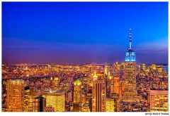 Empire State Building at night with the Manhattan Skyline - Print by Mark Tisdale